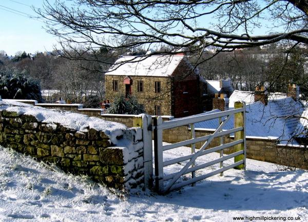 High Mill Pickering in snow from below Pickering Castle's Mill tower.
