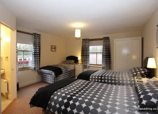 High Mill House bedroom with views of NYMR. Pickering holiday cottages